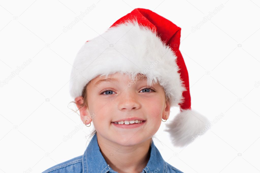 Girl with a Christmas hat against a white background — Stock Photo #11209042