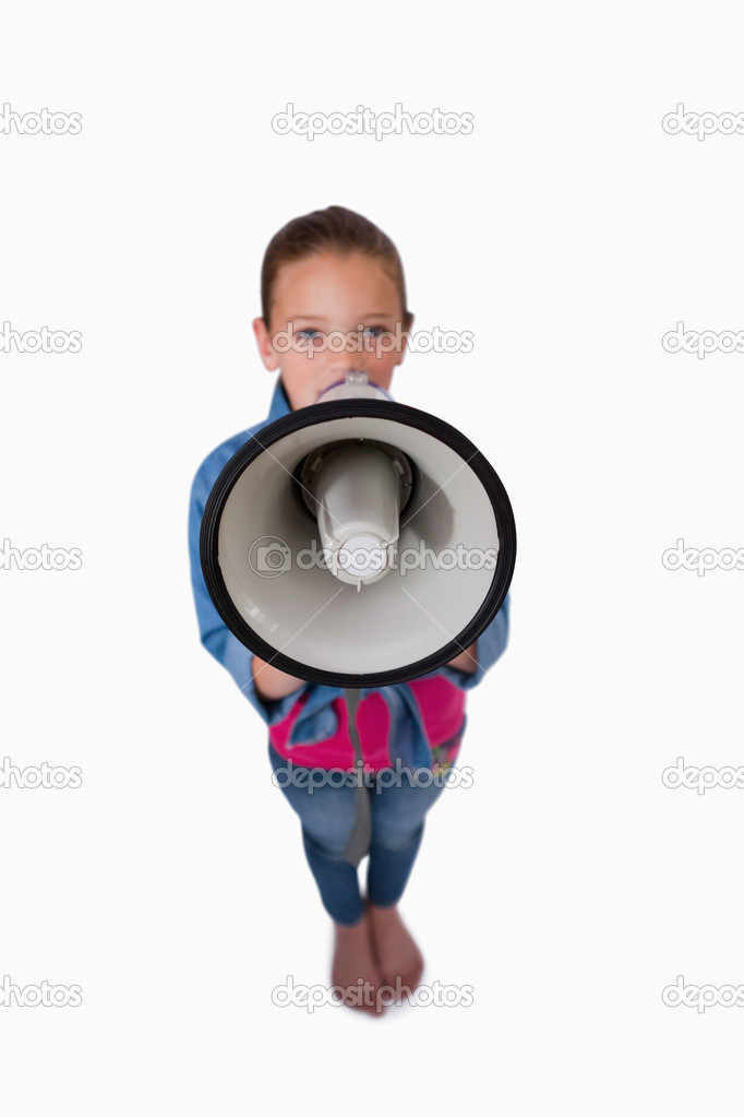 Portrait of a girl speaking through a megaphone against a white background — Stock Photo #11209058