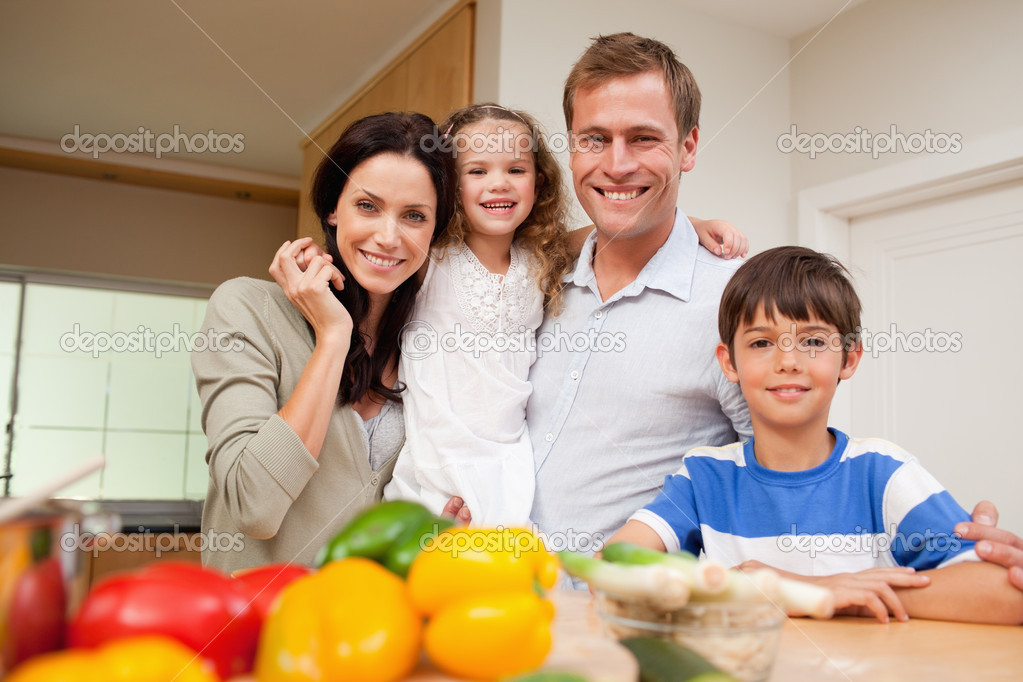 happy family standing in the kitchen  stock photo, Kitchen