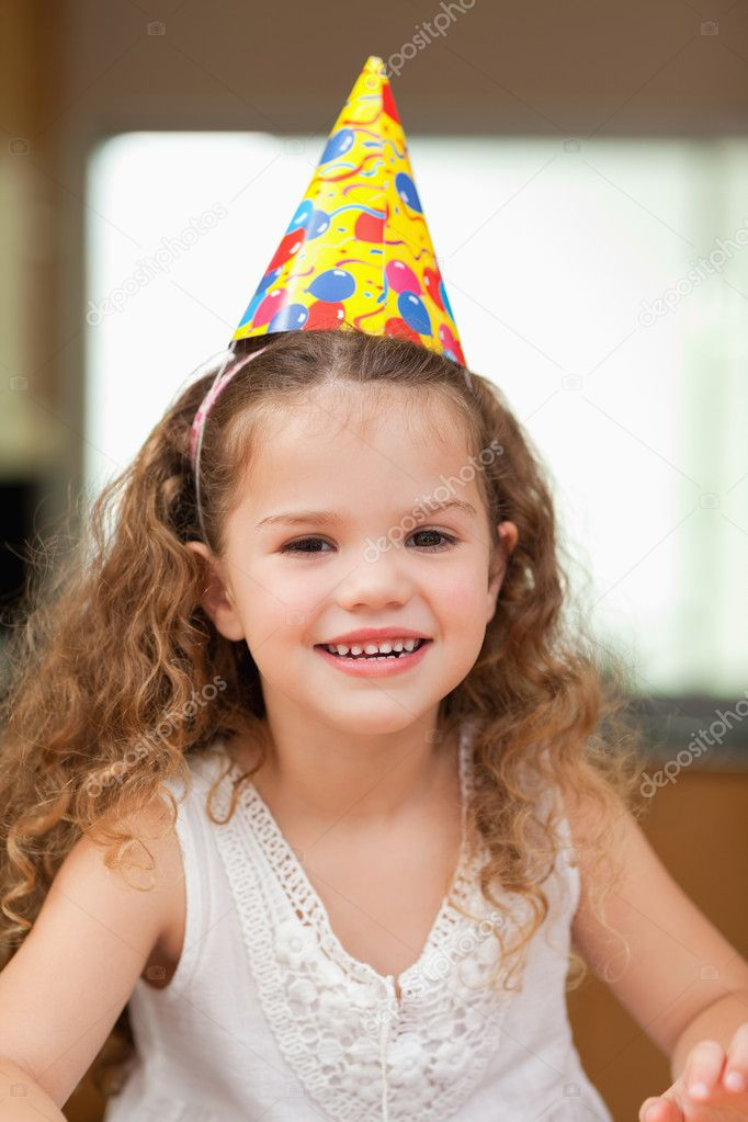 Smiling girl with party hat — Stock Photo #11209621