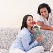 Stock Photo: Couple in the living room together on valentines day