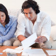 Stock Photo: Couple depressed about financial problems