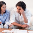 Stock Photo: Couple talking about financial problems