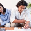Sad couple checking their bills — Stock Photo