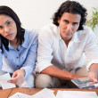 Stock Photo: Couple calculating their costs