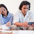 Stock Photo: Couple checking bills