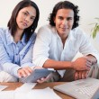 Stock Photo: Couple paying their bills online