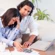Couple worried about their finances - Stock Photo