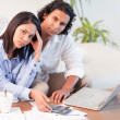 Stock Photo: Couple having a hard time paying their bills