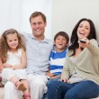 Family watching comedy together — Stock Photo