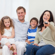 Foto de Stock  : Family watching comedy together