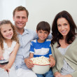 Stock Photo: Family watching movie together