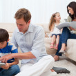 Family spending spare time in the living room — Stock Photo