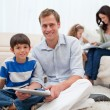 Family spending free time in the living room — Stock Photo
