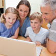 Lovely family using a laptop — Stock Photo