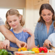 Lovely family cooking together — Stock Photo