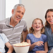 Family watching a movie - Stock Photo