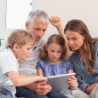 Family using a tablet computer — Stock Photo