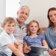 Royalty-Free Stock Photo: Smiling family using a tablet computer