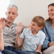 Royalty-Free Stock Photo: Cheerful family playing video games
