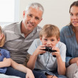 Royalty-Free Stock Photo: Charming family playing video games