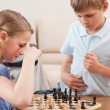 Siblings playing chess — Stock Photo