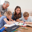 Stock Photo: Parents helping their children to do their homework