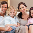 Happy family watching television together — Stock Photo