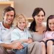Cute family watching television together — Stock Photo