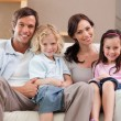 Stock Photo: Portrait of a family watching television together