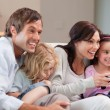 Delighted family playing video games together — Stock Photo