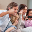 Positive family playing video games together — Stock Photo