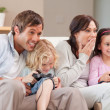 Royalty-Free Stock Photo: Competitive family playing video games