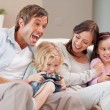 Laughing family playing video games — Foto Stock