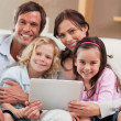 Portrait of a family using a tablet computer — Stock Photo #11210741