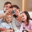 Happy father taking a picture of his family — Stock Photo #11210743
