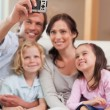 Portrait of a father taking a picture of his family — Stock Photo
