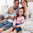 Stock Photo: Portrait of a family relaxing in their living room