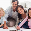 Smiling family drawing together — Stock Photo