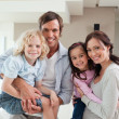 Stock Photo: Charming family posing together