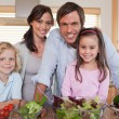 Family preparing a salad - Stock Photo