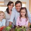 Family preparing salad — Stock Photo #11210794