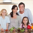 Family preparing a salad together — Stock Photo