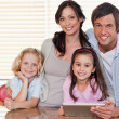 Stock Photo: Smiling family using a tablet computer together