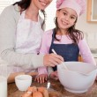 Stock Photo: Portrait of a happy mother baking with her daughter