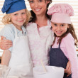 Portrait of a mother and her children baking — Stock Photo #11210861