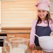 Stock Photo: Little girl baking