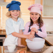 Stock Photo: Siblings baking together