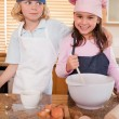 Portrait of siblings baking together - Stock Photo