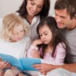 Portrait of a family reading a book — Stock Photo #11210899